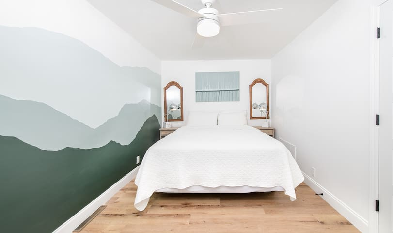 Large queen bedroom with mountain mural and original art work.