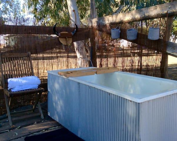 Have an outdoor artesian bath under the stars