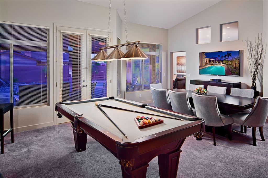 Fun game room with pool table and large high definition television - perfect for watching the latest sporting event.