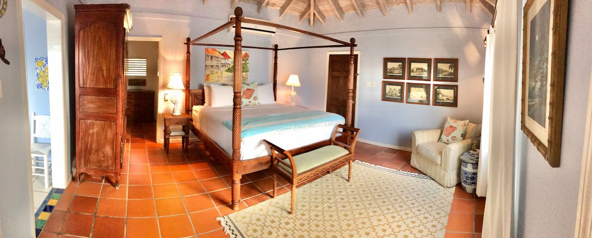 Master bedroom with ensuite bathroom private deck and outdoor shower.
