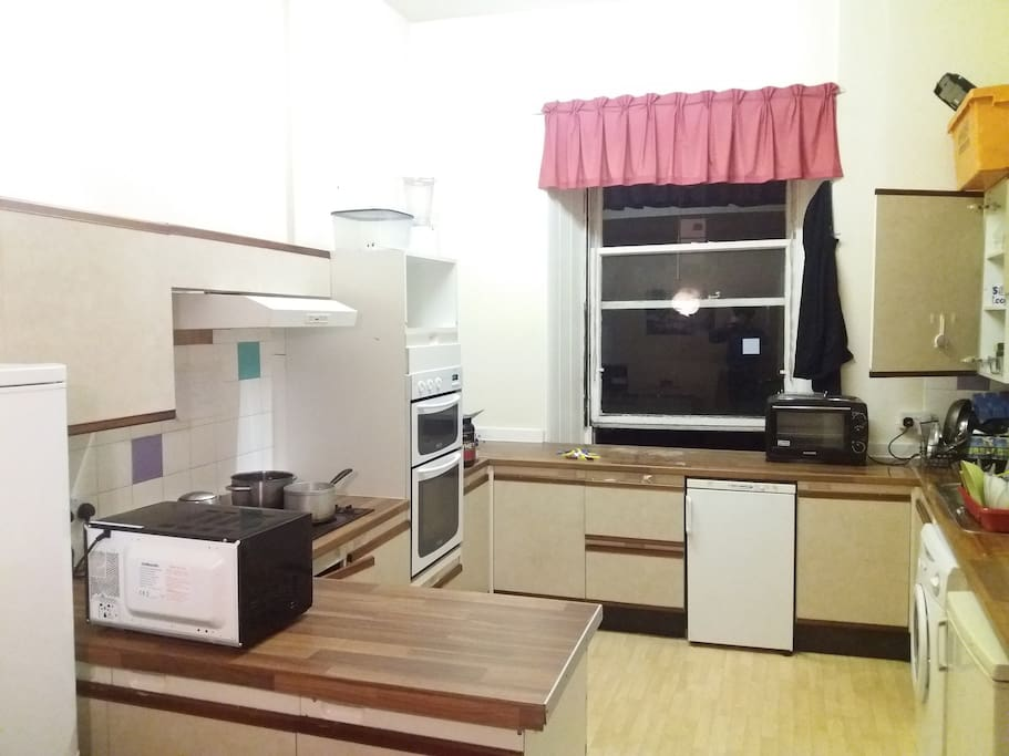 The kitchen, fully furnished and ready to be utilised for all your cooking needs.