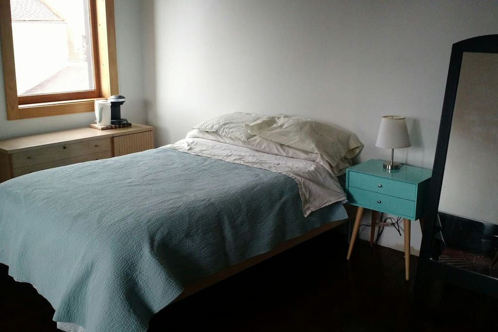 This photo shows the full sized mattress, nightstand, coffee pot and tea kettle.  No need to go to the kitchen for a cup of coffee or tea.  During the spring, summer, and fall linens are air dried in the garden.