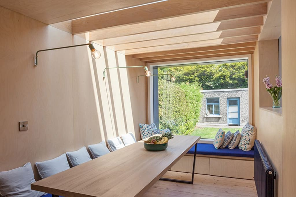 Dining cube with glass rooflight and picture window