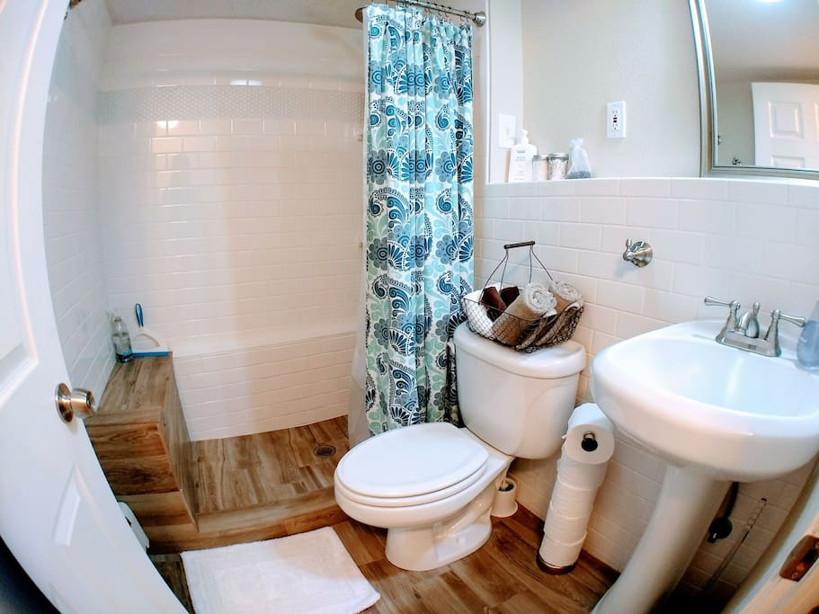 Enjoy a refreshing shower in our modern bathroom, stocked with lotion, cotton balls, and q-tips as well as shampoo, conditioner, and body wash.