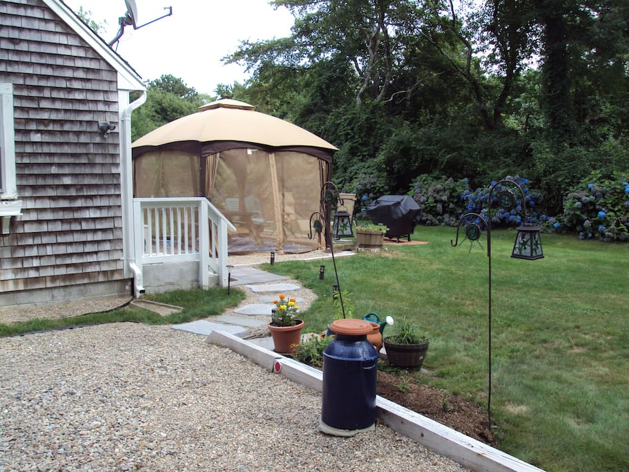Screen house gazebo with picnic table for outdoor eating!