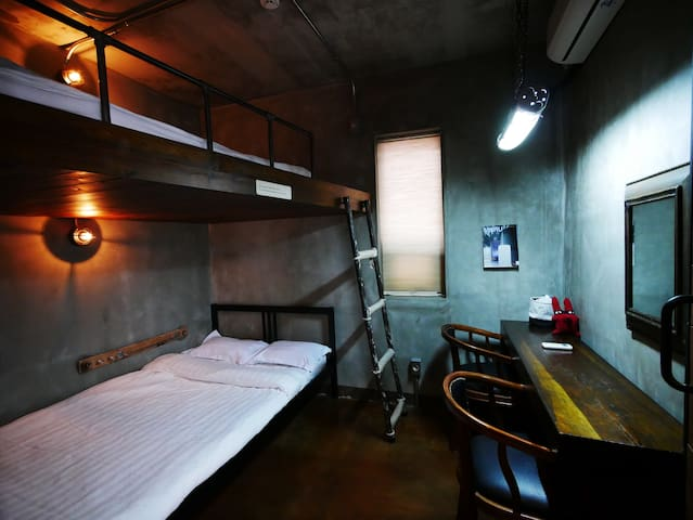 Duplex room with industrial design
