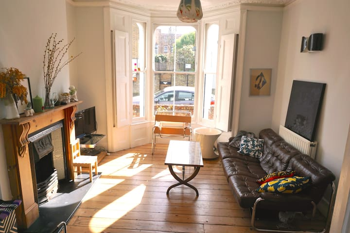 large 2 room sunny lounge with working fireplace and original shutters