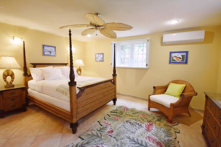 One of three bedrooms downstairs - queen bed, a/c, ceiling fan