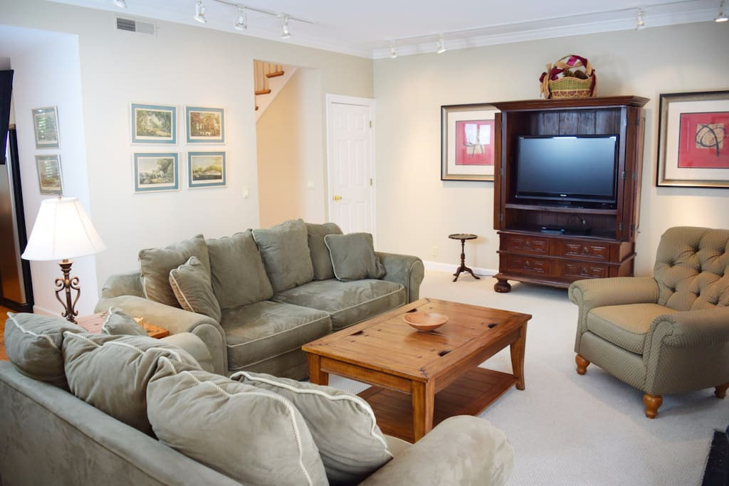 Comfortable living room area with great Cable TV package, sports channels, Netflix, and DVD player.