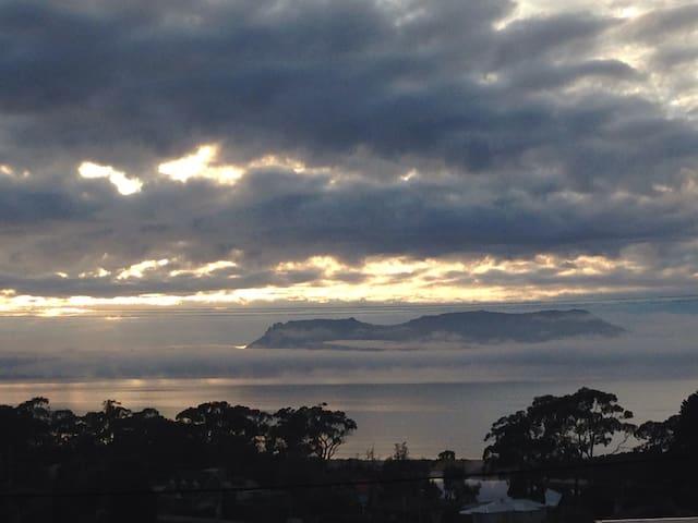 View of Maria Island from the B&B.   Beautiful sea mist hugging Maria Island.
