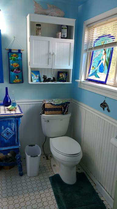 Ocean themed bathroom gives a vacation vibe.