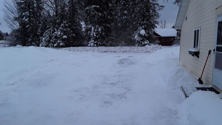 Large, flat driveway, over 100 feet long, for trucks and trailers.