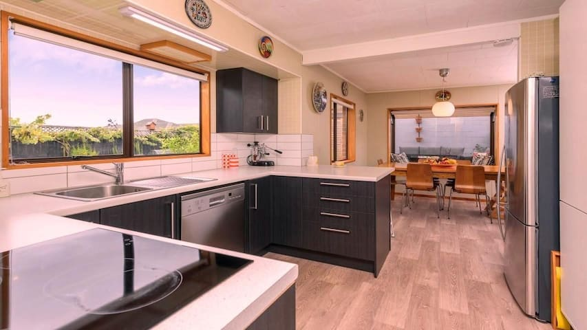 Modern kitchen with all amenities, including 4 slice toaster, yoghurt maker, Nutribullet, Nespresso, Breville Barista Espresso machine and good variety of tea and coffee for you.
