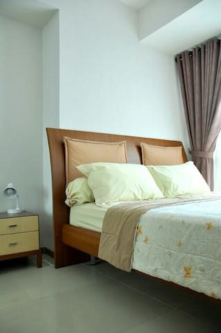 Second bedroom with queen size bed for 2 person and complete sets of pillows, bolsters and comforter.