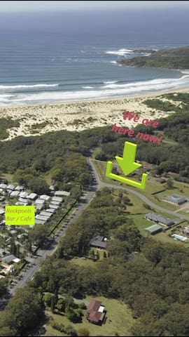 Yes, there is a track across a narrow strip of National Park to beautiful One Mile Beach.