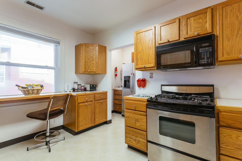 """Large """"eat-in"""" Kitchen with gas stove, Microwave, dishwasher,refrigerator, toaster and coffee maker."""