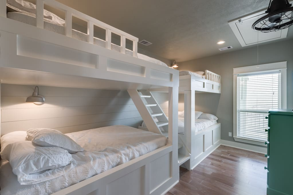Large bunk room with 4 FULL size bunks. This is on the second floor and shares a jack and Jill bathroom with bedroom #3 .