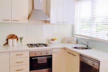 Kitchen with Oven, Dishwasher & microwave.