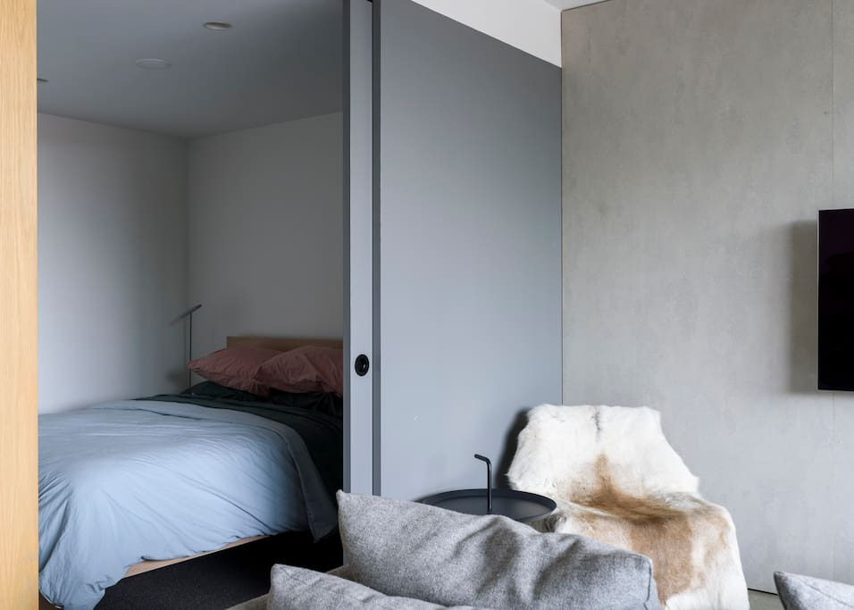 Our hotel-grade bed is fitted with Jardan linen. The bedroom includes favourite items from Muuto and Hay.