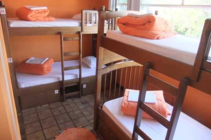 Quarto Laranja · A bed in shared mixed Dorm with 8 beds