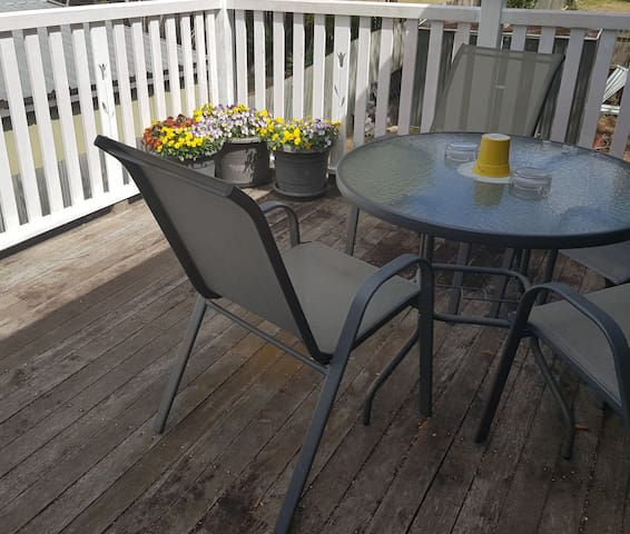 Elfresco dining or a picturesque place to sit and relax on deck off kitchen