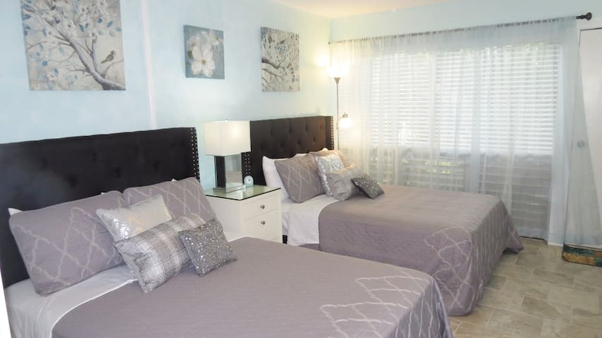 Two comfortable full-size beds are in the bedroom.