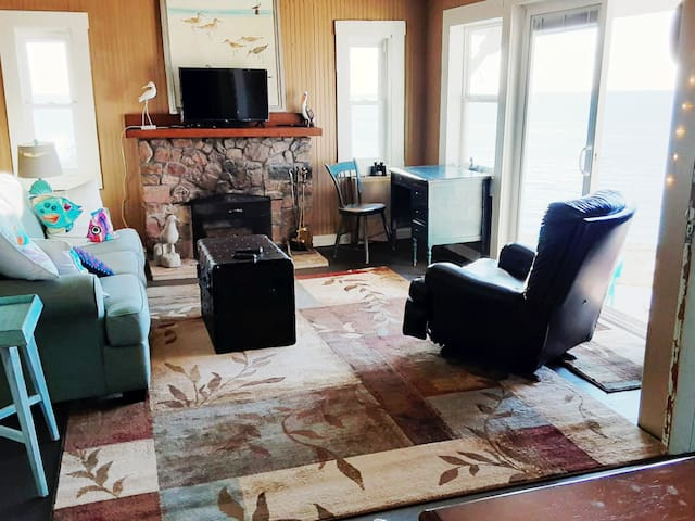 Living room overlooking the lake, with  fireplace!