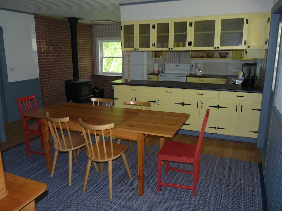 Dining room and kitchen -- fully stocked with plates, cutlery, pots, pans, bowls, tools etc.