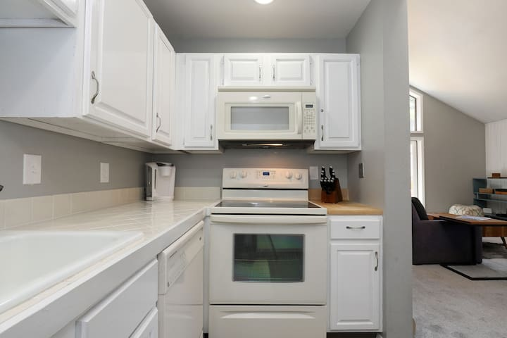 Kitchen includes stove, oven, microwave , refrigerator and dishwasher.