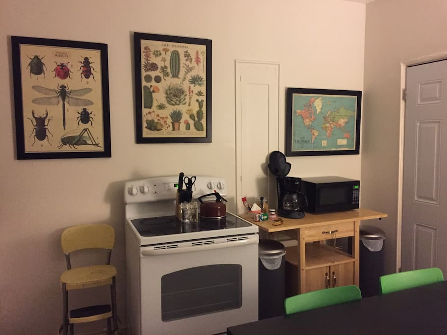 Kitchen/stove/microwave/coffee pot/coffee/creamer/sugar/tea/honey/backdoor with screen gate/giant kitchen table/3 chairs/ toaster/fridge