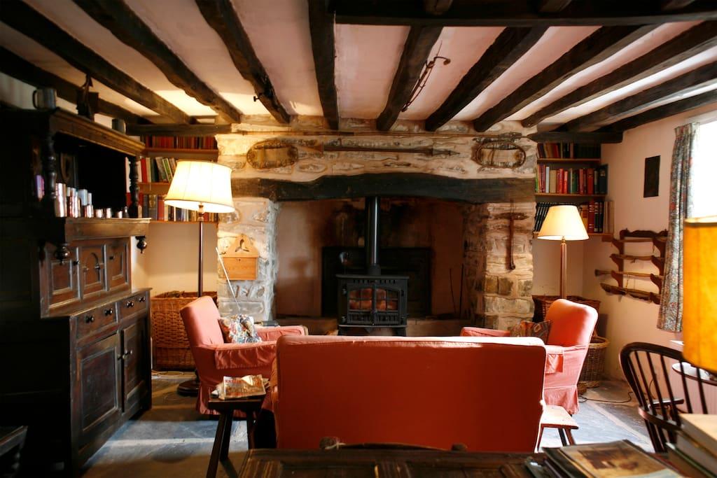 Original beams and fireplace, new log burner