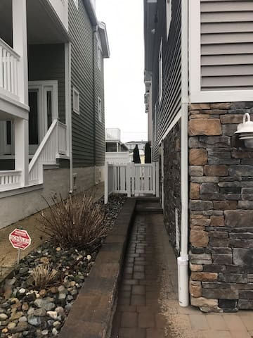 Entrance to side garage door and backyard