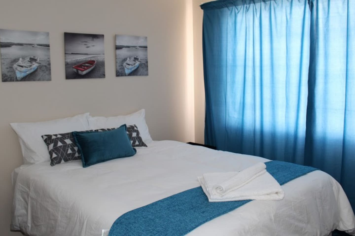 The Blue room with a private bathroom, can accommodate up to 4 guests.
