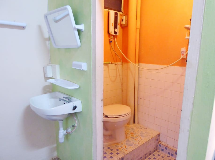 Bathroom with hot water shower.  Toiletries are provided