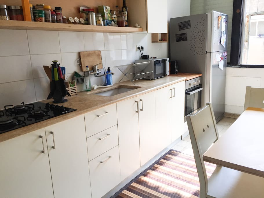 Kitchen- includes: oven, microwave, cold/hot water bar
