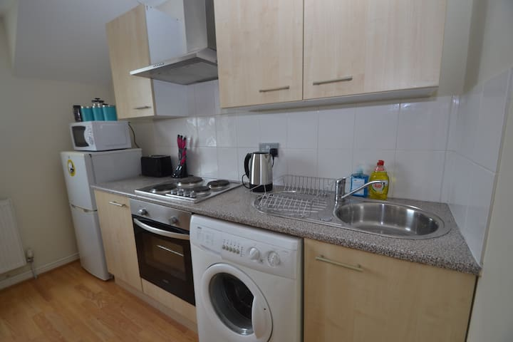 Well equipped kitchen with crockery, cutlery, cooking utensils, saucepans making it ideal for entertaining or just eating in