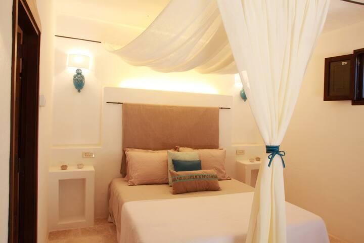 Trulli Saurizzi: Turquoise room Puglia (ZooSafari) - Fasano - Bed & Breakfast