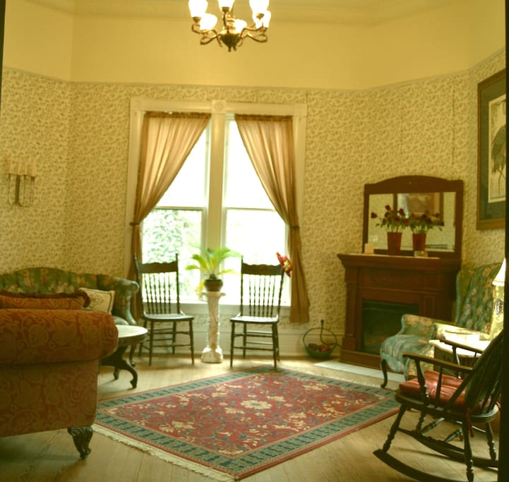 The parlor suite with pressed tin ceiling is an elegant room for relaxing or visiting.
