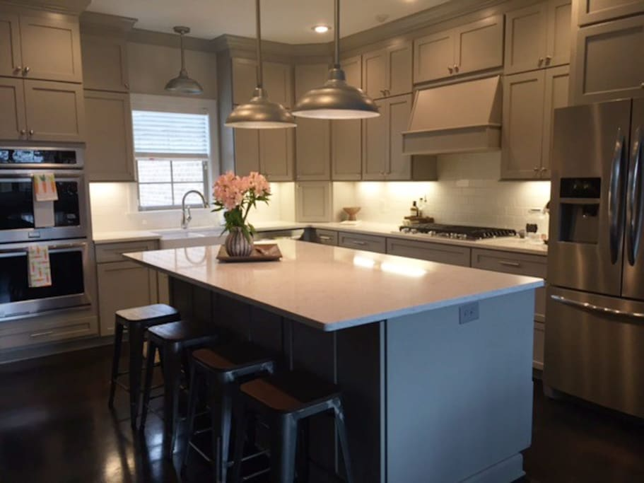 Spacious kitchen provides double ovens, gas stove and Keurig for guests.