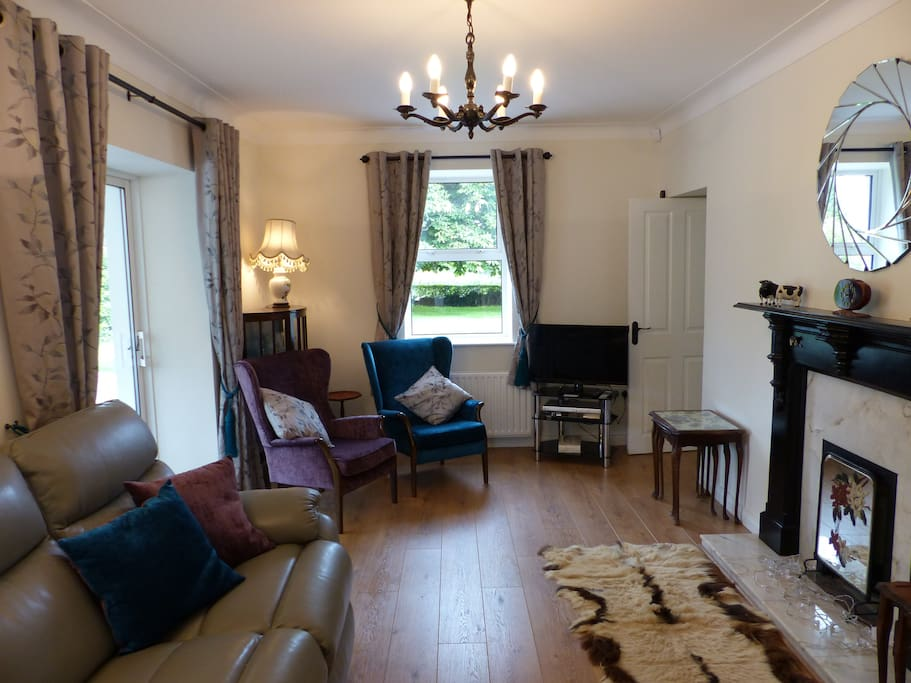 Living Room leading to Conservatory, Study and Kitchen