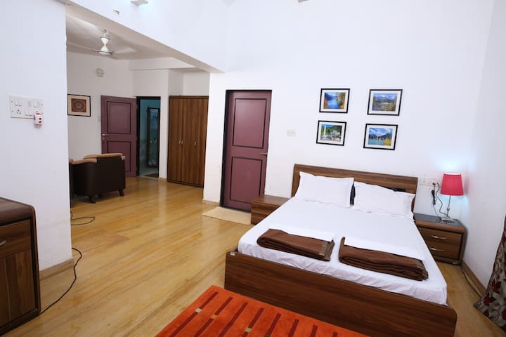 Bedroom with two double beds with Ac & attached shower and toilet