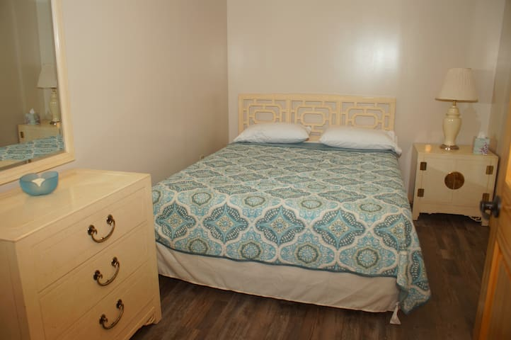 Queen bedroom #1 with chest, ground floor.