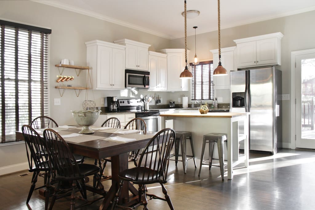 Open floor plan and 10' ceilings open up and allow for easy movement between kitchen, dining and living areas with fully equipped kitchen and expandable dining room table to seat up to 8!