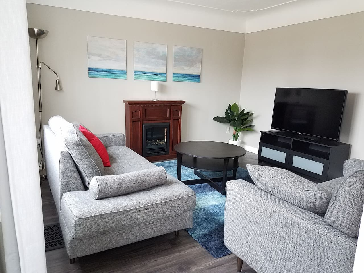 The elegant and essential livingroom features an electric fireplace, a 4k television and a daybed to cozy up in and relax.   The television is internet connected so you can stream your favorite shows.