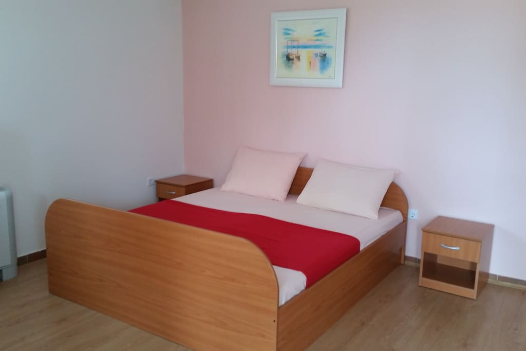 Double bed is situated in the living room.