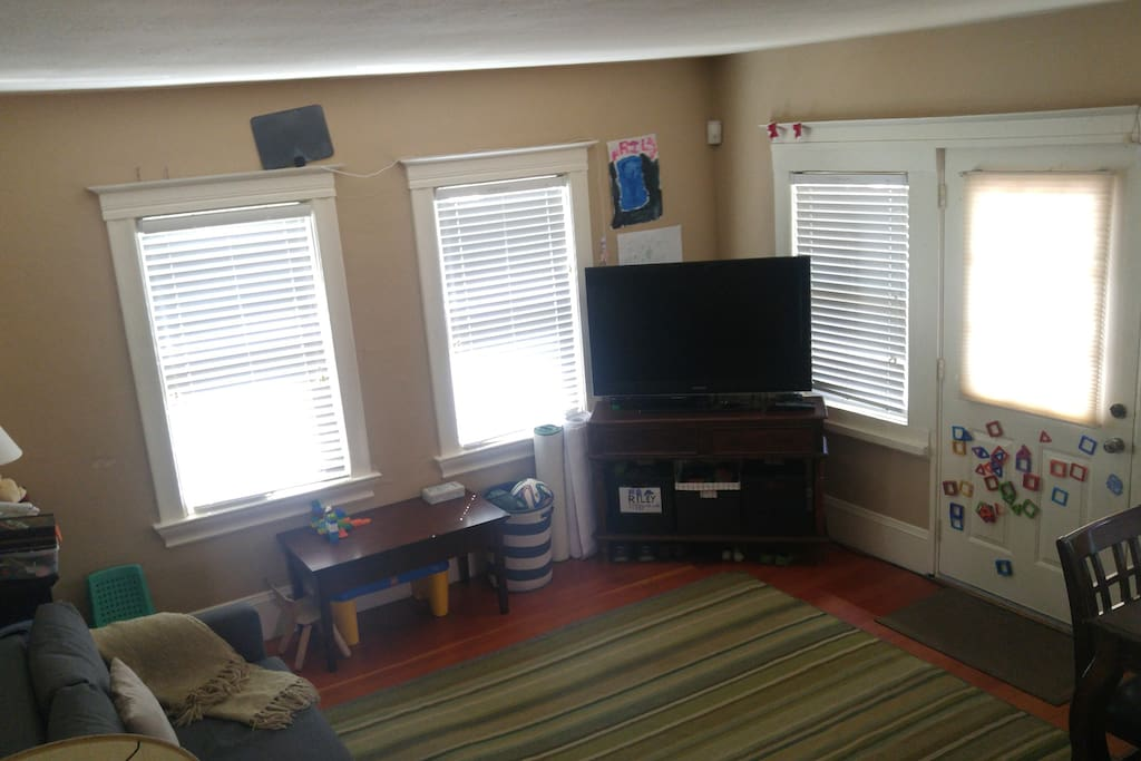 Living room showing TV and door out to large deck