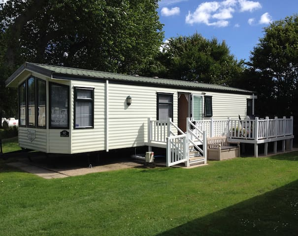Cleethorpes Caravan with scenic lakeside view.