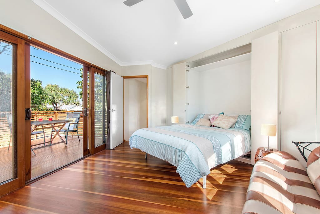 Listen to the sound of the ocean from the upstairs bedroom with private balcony.