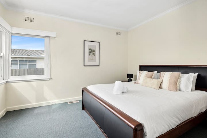 The master bedroom features a king size bed & flat screen TV.