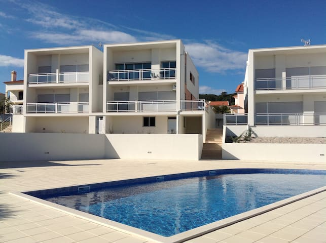Apart. Safe family friendly beach and shared pool.